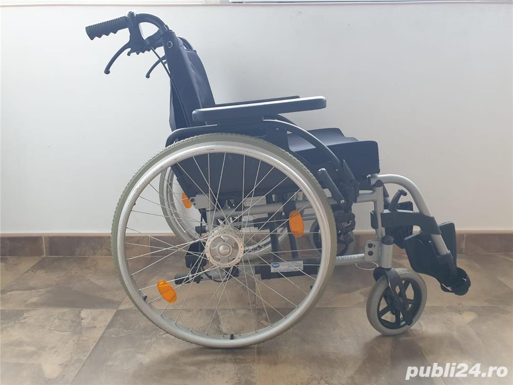 Carucior handicap cu rotile