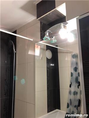 Spre închiriere apartament 2 camere zona ultracentral - piața 700 - imagine 12