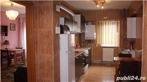 Apartament cu 3 camere si 2 bai in zona centrala - imagine 5