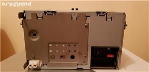 Vind Radio Cd original Skoda Octavia.In ecran se vad mâinile si telefonul,nu are nici un defect. - imagine 2