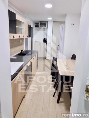 Apartament cu 3 camere,decomandat in zona Lipovei - imagine 2