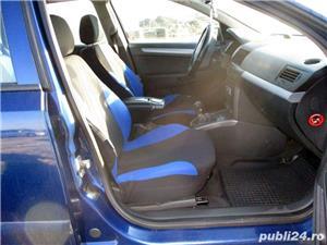 Opel Astra H Caravan 1.7 CDTI - imagine 9