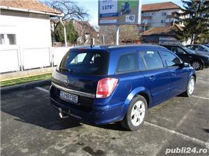 Opel Astra H Caravan 1.7 CDTI - imagine 6