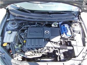 Mazda 3,motor 1.4 benzina,euro 4,import Germania,super pret 1850 euro - imagine 10