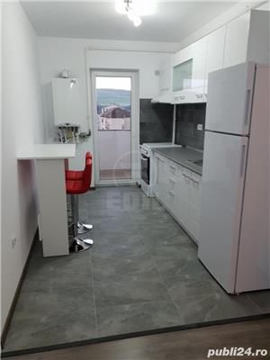 Apartament 2 camere, finisat,mobilat,utilat nou zona centrala Floresti - imagine 3
