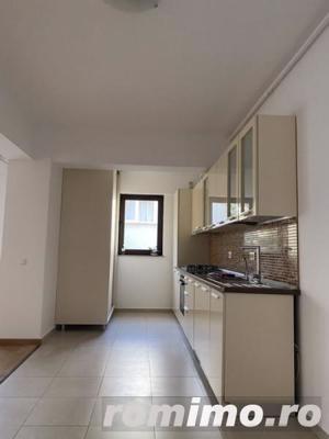 Apartament 3 camere nemobilat + 1 loc de parcare in garaj subteran - imagine 2