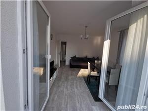 Privat. Apartament 2 camere utilat, mobilat; parcare subtera - imagine 1
