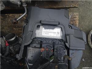 Vand Calculator Motor Ecu Ford Fiesta 1.6 TDCI Euro5 din 2012 cod:AV21-12A650-RF - imagine 1